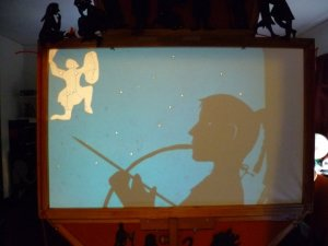 Artemis watching Orion (puppet and background on screen)